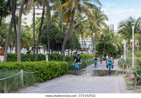 MIAMI, USA - DEC 9, 2015: People on bicycles on South Beach Boardwalk in Miami Beach, Florida, USA