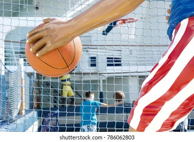 Miami, USA - December, 22, 2017: Kid playing basketball at the sports deck of a cruise