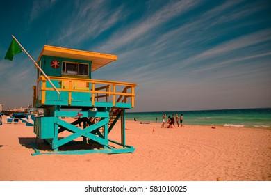 Miami, USA - January 28, 2017; A lifeguard tower on Miami south beach with a blue sky.