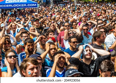 MIAMI, USA - July 13, 2014: Soccer fans watch the Brazil World Cup 2014 final match between Argentina and Alemanha in Miami, Florida.