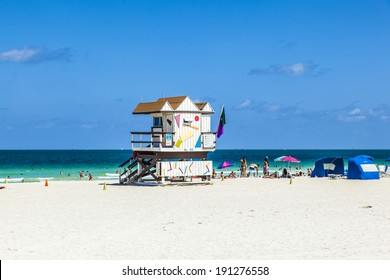 MIAMI, USA - JULY 27: people enjoy beach life on July 27, 2010 in Miami, USA. South beach is famous for its wooden lifeguard towers which are designed in Art deco style.