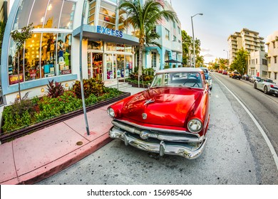 MIAMI, USA - July 31: classic Ford car parks in the art deco district on July 31, 2013 in Miami Beach, Florida. Art Deco Life in South Beach is one of the main tourist attractions in Miami.