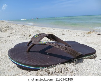 Miami / USA - June 2015: Summer shoes, beach sandals, Havaianas in the sand of Mid-Beach.