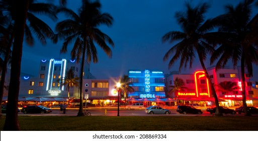 MIAMI, USA - JUNE 7, 2012: Palm trees and art deco hotels at Ocean Drive. The road is the main thoroughfare through South Beach. South Beach, Miami, Florida, United States of America, june 7 2012