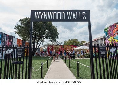 MIAMI, USA - MARCH 19, 2016: Wynwood Wall entrance with people. The Wynwood Art District Association was founded in early 2003 by a group of art dealers, artists and curators.