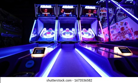 Miami, USA - March 8, 2020 - Beautiful and colorful Wide show view of skee ball Arcade Game in an amusement park.
