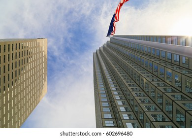 MIAMI, USA - MAY 20, 2016: Looking up the skyscrapers Southeast Financial Center and Miami Center in downtown with the American flag in front.