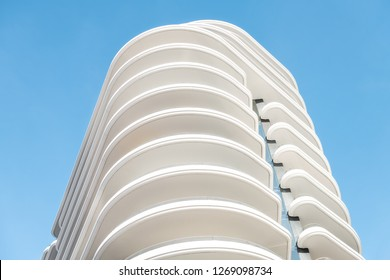 Miami, USA - May 5, 2018: Abstract view on residential apartment complex building with many balconies and floors isolated against blue sky on sunny day