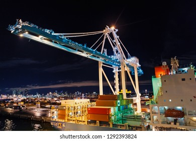 Miami, USA - November, 23, 2015: freight, shipping, delivery, logistics, merchandise. Maritime container port with cargo containers cranes at night Port or terminal with night illumination