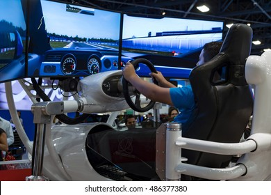 MIAMI, USA - SEPTEMBER 10, 2016: Visitor enjoys the Ford racing simulator during the Miami International Auto Show at the Miami Beach Convention Center.