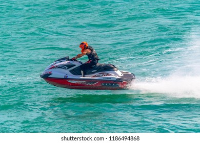 Miami, USA-July 20,2018: Jet ski speed recreation in urban waters of the Biscayne bay.  The rental of this equipment and the recreation outdoors is a tourist attraction in the Florida city