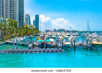 Miami, USA-July 5, 2018: Marina in Biscayne bay in Miami city. Many private boats in a blue clear sky day. Miami is a seaport city at the southeastern corner of the U.S. state of Florida.