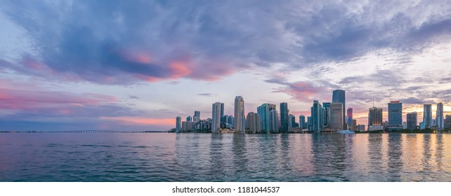 Miami, wide panorama of urban skyline at beautiful sunset, vivid and dramatic sky