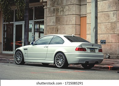 Miami, Year 2015: Rear view of white BMW M3 (E46) parked on the street.