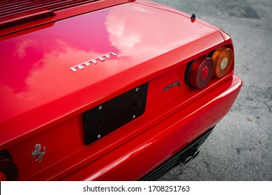 Miami, Year 2019: Backside of classic Ferrari Mondial T. Color Red, brand logo, model logo, tail lights, bumpers and tailpipes.