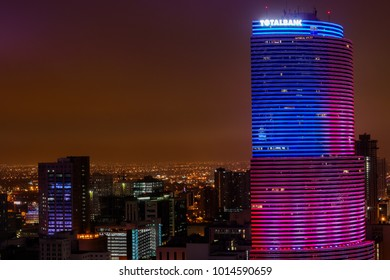Miami,FL / USA - Jan 31 2018: TotalBank building view at night with US flag lighting.