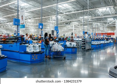 Miami/USA - April, 25 2019:Cashier counter in Walmart. Walmart Inc. is an American multinational retail corporation  operates a chain of hypermarkets, discount department stores, and grocery stores