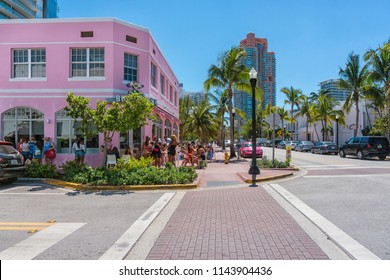 Miami,USA-march 15,2018:people walking around the streets and locals of Miami during a sunny day