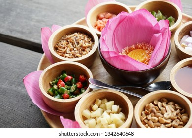 Miang kham old traditional snack in Thailand. Lotus leaf and side dish such as chilil, lemon, small nut wih Sweet sauce.