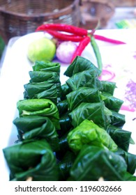 Miang Kham (Royal leaf wrapped appetizer), an ancient Thai cuisine made from wrapping various ingredients into wild piper leaves.