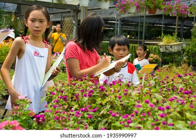 Miaoli County, Taiwan-August 13, 2008: A group of children are doing outdoor teaching in the garden