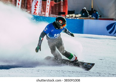 Miass, Russia - February 20, 2016: male snowboarder finish line after race during Snowboard World Cup - Snowboard Cross