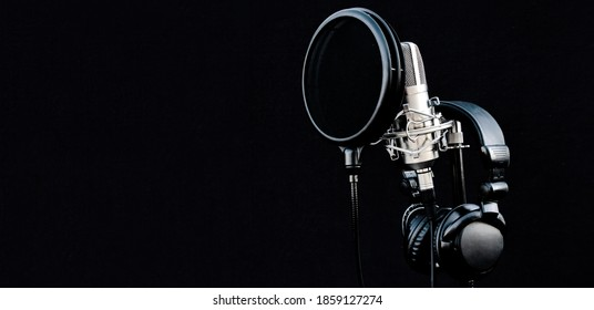 Mic condenser on mic stand with pop filter and headphones