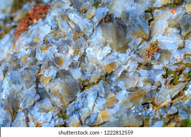 The mica sheets and quartz silicate minerals. Bare geological rock in soft sludge clay rocks. Macro lens shot.