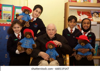 Michael Bond, creator and author of the Paddington Bear books with children from Paddington Green Primary School, London on 16-01-2016