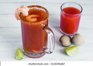 Michelada beer with tomato juice, shrimps, clam and lemon, mexican drink cocktail in mexico
