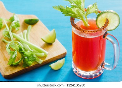 Michelada, beer with tomato juice, spicy sauce and lemon, mexican drink cocktail in mexico