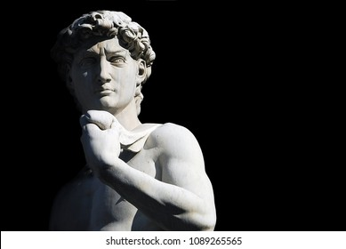 Michelangelo's David statue on black background, with place for your design or text