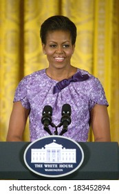 Michelle Obama, in an Anne Klein New York dress, at a public appearance for Afternoon Tea Honoring Women in the Military, East Room of the White House, Washington DC, DC November 18, 2009
