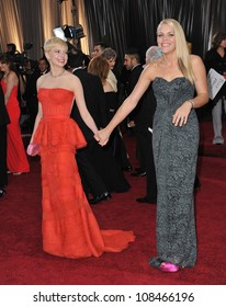 Michelle Williams & Busy Philipps at the 84th Annual Academy Awards at the Hollywood & Highland Theatre, Hollywood. February 26, 2012  Los Angeles, CA Picture: Paul Smith / Featureflash