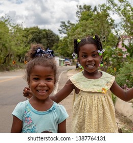 Miches, Dominican Republic, 16 april, 2019 / Local happy haitian or dominican kids playing on the side of the road, smiling