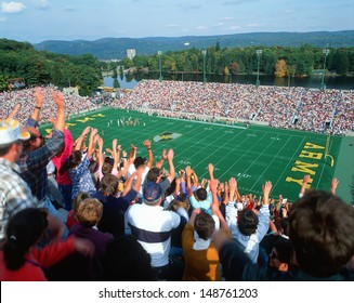 MICHIE STADIUM, NEW YORK - CIRCA 1986: Crowd doing the wave at a college football game in Michie Stadium, New York