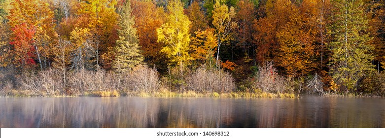 Michigamme Morning Autumn color along the Michigamme River in Michigan's Upper Peninsula.