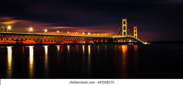 Michigan Mackinaw Bridge Illuminated Panorama. The Mackinaw Bridge is part of I-75 connects Michigan's Upper and Lower Peninsula's and is one of the longest suspension bridges in the world.