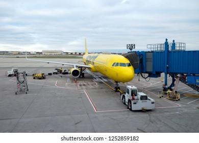MICHIGAN, US - NOV 17, 2018: A Spirit Airlines yellow Airbus A320 airplane parked at Detroit Metropolitan Airport in Michigan, United States.