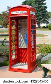 Michigan, USA, August 13, 2018: Red English phone booth - USA, Suttons Bay city as information stand