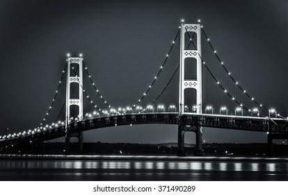 Michigan's Mackinaw Bridge At Night. The Mackinaw Bridge spans the straits between the Upper and Lower Peninsula of Michigan.