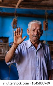 Michoacan, MEXICO - july 22, 2012: very hard-working old man with his hand full of calluses and scabs because he has worked a lot in the traditional elaboration of jorongos and zarapes