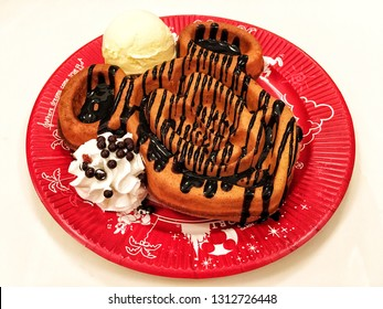 Mickey-Shaped Waffle Topped with Chocolate Sauce and Vanilla Ice Cream