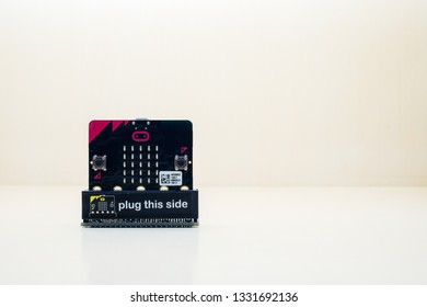 Micro bit is a small electronic device used to learn modern technology as a basis for programming in computer science and computing science. Concept Modern education. With copy space wooden background