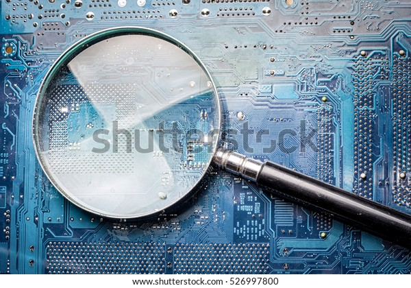 micro chip scanning with magnifying glass, searching for bugs
