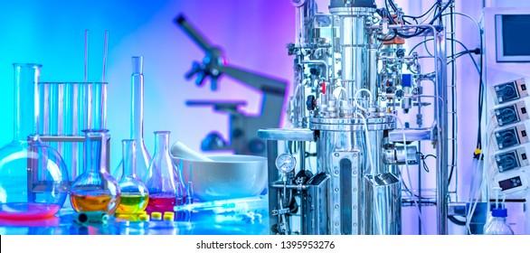 Microbiological bioreactor. Growing bacteria. The process of biofermentation. Bioengineering. Production of antibiotics. Creation of medicines. Pharmacology. Laboratory equipment.