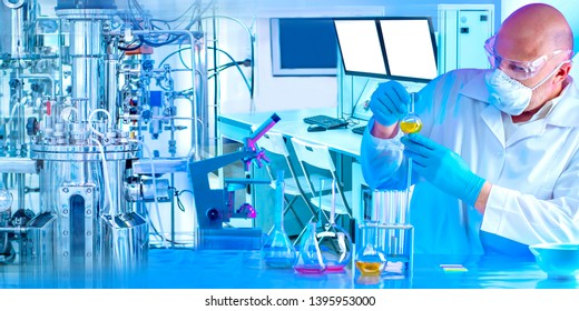 Microbiology laboratory. Male chemist checks the density of the chemical solution Synthesis of microorganisms in the bioreactor. Production of vaccines. The cultivation of biomass. Laboratory equipme
