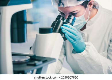 Microbiology, technician working with bacteria strains