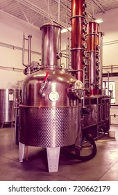 A microbrewery distillery still used to make vodka and whiskey, retro style