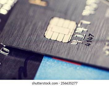 A microchip and raised numbers on a bank card